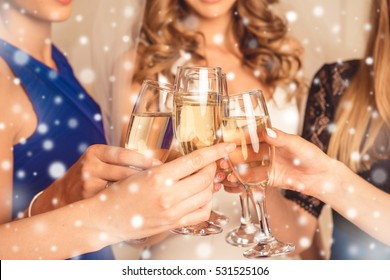 Closeup of girls celebrating new year party with shampagne