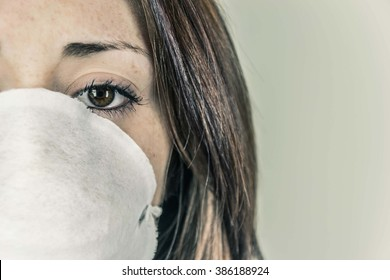 Close-up of a girl's face wearing a mask to defend - concept of smog, pollution, contagious diseases