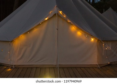 Close-up of glamping bell tent at night. Front view