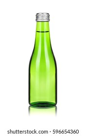Close-up glass bottle with mineral water isolated on white background