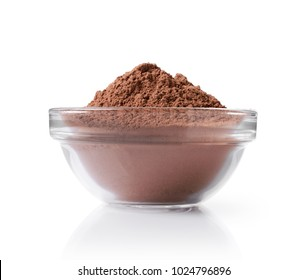 Close-up glass bowl with cocoa powder isolated on white background