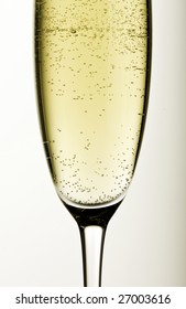 Close-up of a glass of champagne on grey background