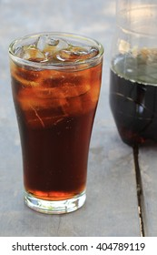 Close-up glass of cola with ice cubes.