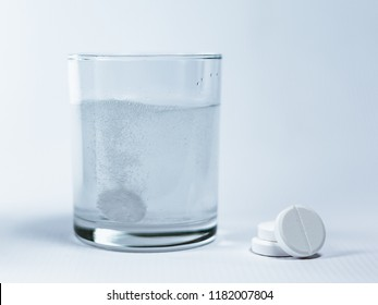 Closeup of a glass of water with effervescent tablets