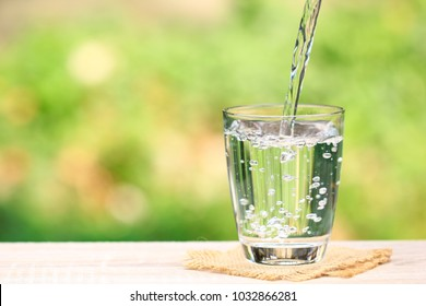 Closeup Glass of water on table nature background