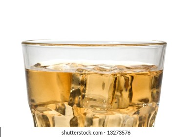 Close-up of a glass of whiskey or scotch, with clear ice cubes.