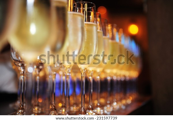 Closeup of glasses of champagne in a row on a table champagne, celebrate, cheer,  cocktail,  glasses