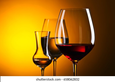 Closeup of glasses with red and white wine