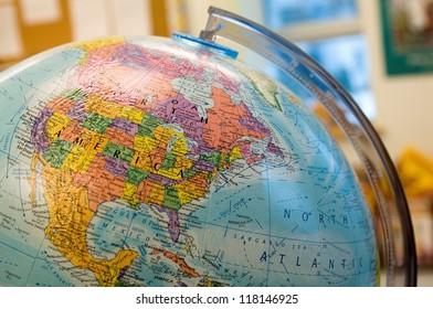 Closeup of a globe in classroom