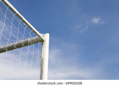 closeup goal corner football with blue sky background.