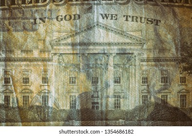 Close-up at In God We Trust & White House, highly magnified surface of used 20 dollars note with visible details of cotton fiber paper, with all flaws, watermarks and traces of usage.