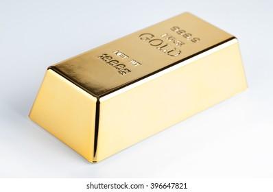closeup of gold bullion on a light background