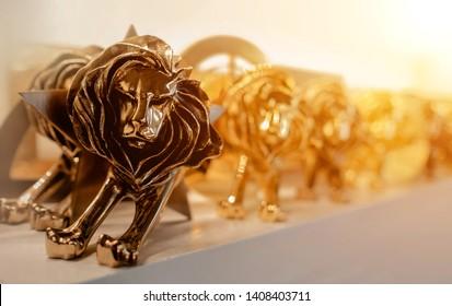 Closeup of gold cannes lion trophy, Shoot at Cannes lions festival 2017, France