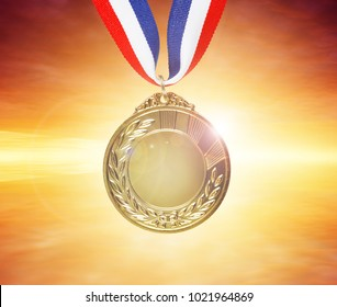 Closeup of gold medal in sky