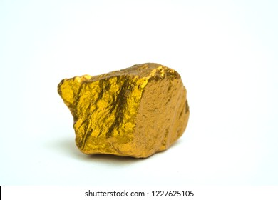 Closeup of gold nugget or gold ore on white background, precious stone or lump of golden stone, financial and business concept idea.