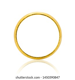 Closeup of gold ring for wedding isolated on white background.