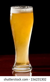 closeup of a golden ale served in a cold pint