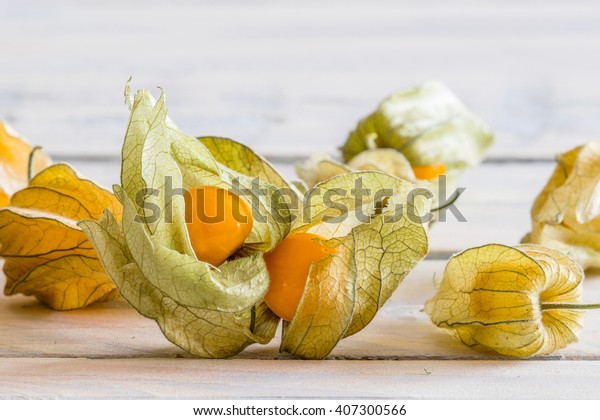 Close-up of golden berries on a wooden table