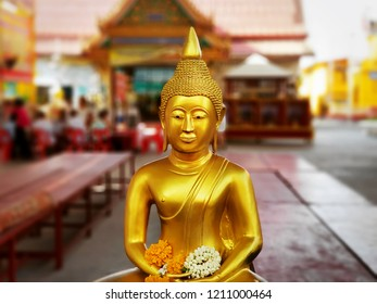 Close-up Golden Buddha Image at Buddhist Temple