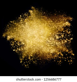 Closeup golden glitter explosion. Dust particle isolated on black. Abstract background. Color explosion