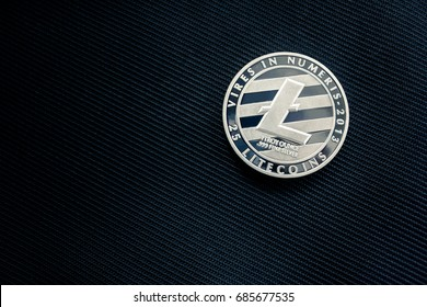Closeup of Golden Physical Litecoin on Vintage Luxury Modern Blue Background, New Virtual Money Symbol