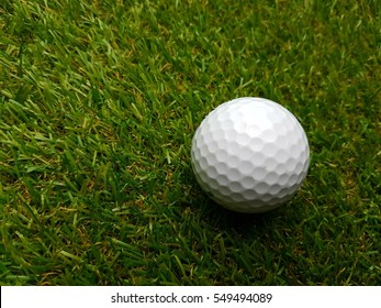 Closeup of golf ball with selective focus.
