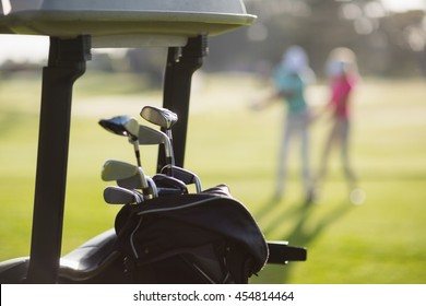 Close-up of golf clubs in bag