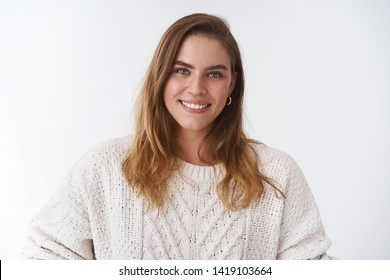 Close-up good-looking charming feminine adult woman wearing cozy sweater smiling broadly white teeth gazing camera sincere delighted expressing relaxed positive vibe, feeling happy
