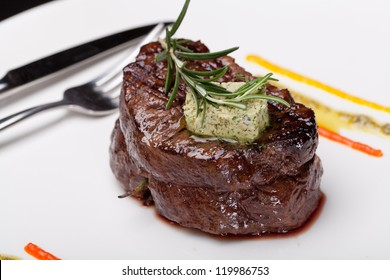 Closeup of a gourmet dinner plate with a steak, vegetables and potatoes
