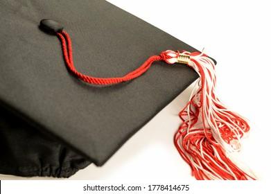 A closeup of a graduation mortar board cap and tassle for educational ceromonies.