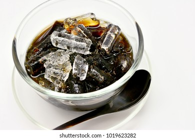 Close-up grass jelly (Mesona chinensis) with iced on white background.