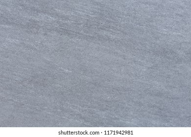 Closeup of a gray stone texture pattern on a porcelain floor tile
