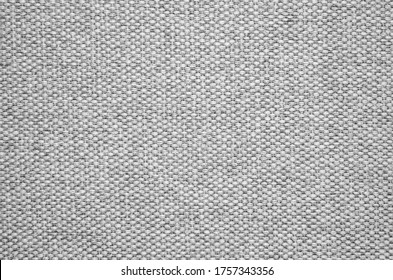 Close-up of a gray textured fabric. Macro shot of gray upholstery for furniture. Wallpaper and background. Closeup grey fabric texture. Thick gray material for the interior. - Shutterstock ID 1757343356