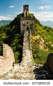 Closeup of Great Wall of China tower in mountains and green countryside