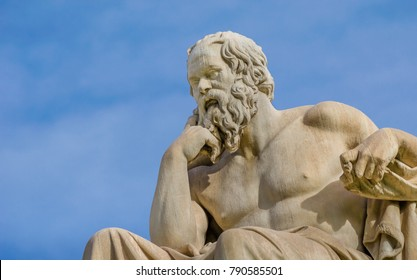 Close-up of a greatest philosopher of Greece Socrates reflects on the meaning of life on the background of blue sky.