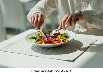 closeup Greek salad with hamon and pasta restaurant