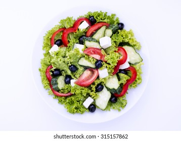 Close-up of greek salad on isolated background