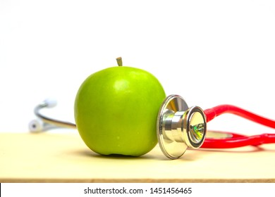 Closeup of green apple and a stethoscope healthy food and concept for diet, Healthcare, Nutrition or medical insurance. Fruit, Examining Cardiovascular Exercise, Environmental Conservation.