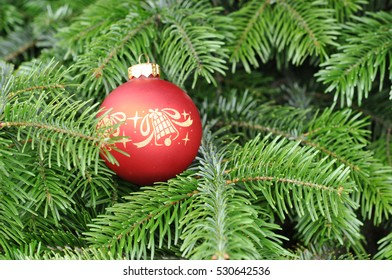 Closeup of Green Christmas tree and ball decorations.