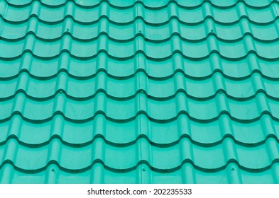 Closeup of the green clay roof tiles
