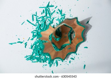 Close-up of green color pencils shavings on a white background