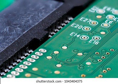 Closeup of green computer mother board, electronic elements and circuit
