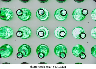 Close-Up of Green Glass Beer Bottles on a Wall