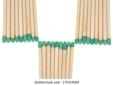 Close-up of a green matches isolated on a white background
