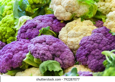 Closeup of green, purple and white cauliflower at a farmers market