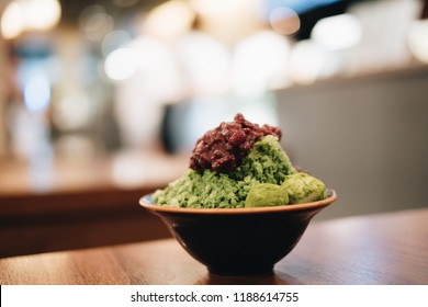 Closeup green tea Bingsu ( or Bingsoo) on tray,Korean shaved ice dessert with sweet toppings with varieties with ingredients, popular dessert.