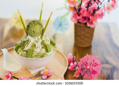Closeup green tea Bingsu on tray, Bingsu or Bingsoo, Korean shaved ice dessert with sweet toppings and fruit and varieties with ingredients,  popular dessert.