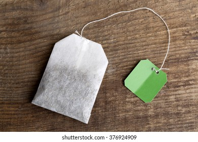 Closeup of green teabag on wooden background