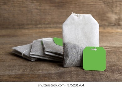 Closeup of green teabags on wooden background