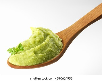 Close-up of green vegetables puree in wooden spoon
